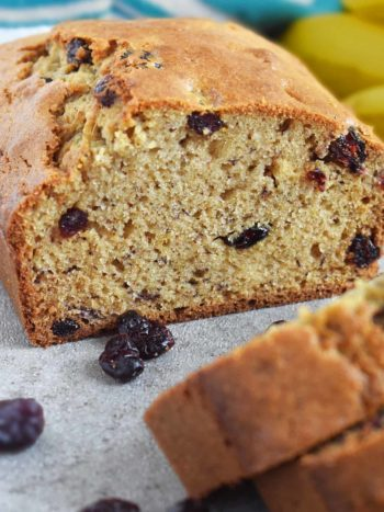 Cranberry Banana Bread is perfectly moist, slightly sweet and loaded with sweet tangy cranberries. This wonderfully moist and soft banana bread is even better with overripe bananas! #olgainthekitchen #bananabread #cranberrybread #cranberrybananabread #bananacranberrybread #bread #easyrecipe #dessert