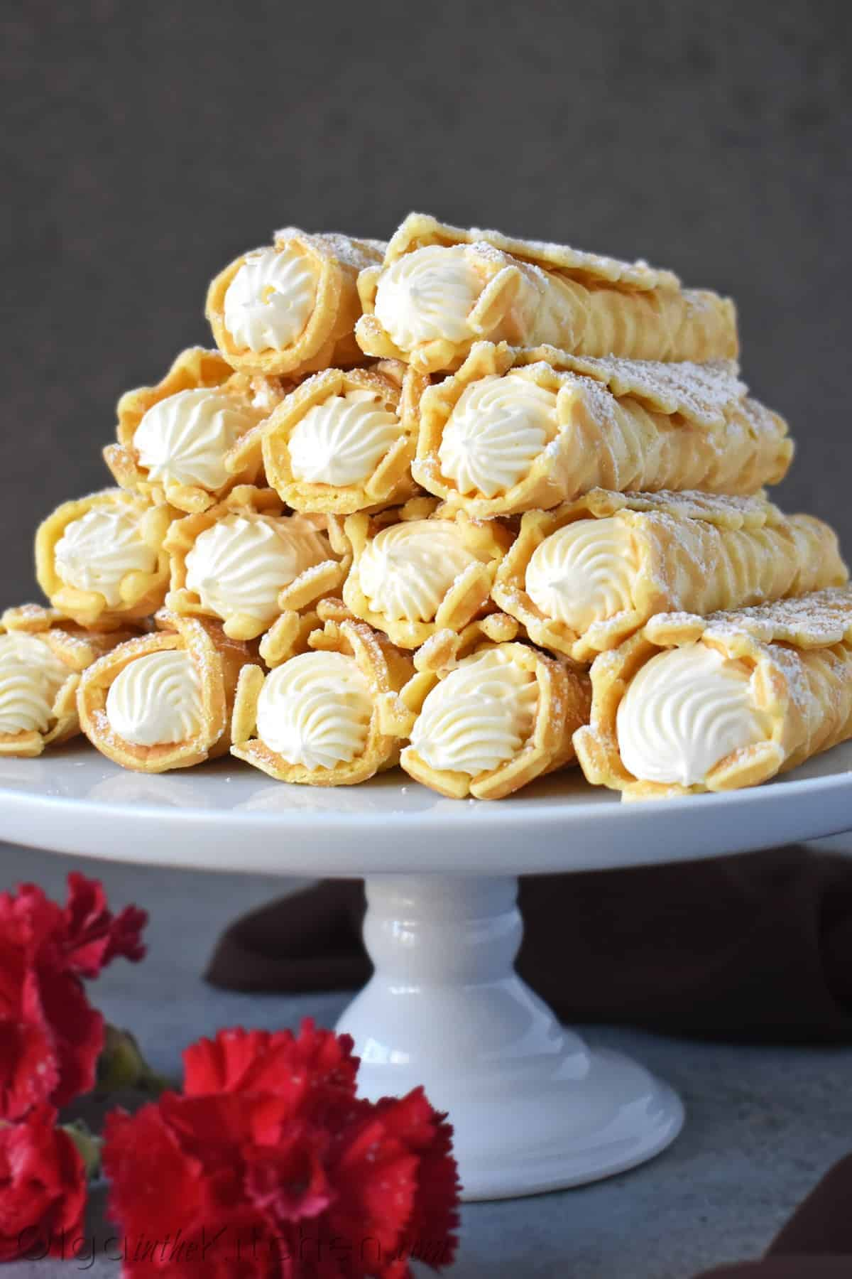 Cream Filled Pizzelles (trubochki): creamy, elegant and beautifully shaped waffle-like pastry filled with the best condensed milk filling. | olgainthekitchen.com