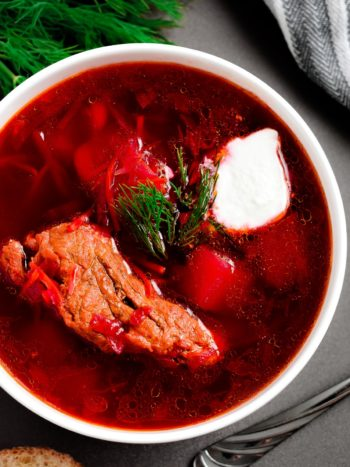 This Classic Red Borscht with Ribs (beet soup) is a traditional Ukrainian dish, loaded with vegetables such as potatoes, beet, cabbage, carrots and more. This hearty soup is very popular and loved by so many all around the world. | olgainthekitchen.com