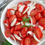 This super Quick Tomato Salad is a summer favorite at every BBQ party. Simple, fresh and delicious and only takes 10 minutes to put together! | olgainthekitchen.com