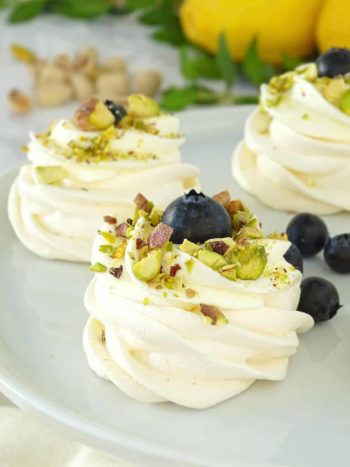 Mini Pavlovas: beautiful, delicious, bite-size dessert for any occasion; crispy on the outside, chewy on the inside. | olgainthekitchen.com