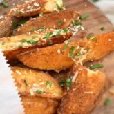 Oven Baked Potato Wedges: a delicious alternative to french fries, seasoned with parmesan cheese and fresh chives. | olgainthekitchen.com