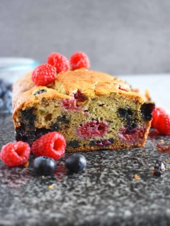 Banana Berries Bread: incredibly moist loaf of banana bread loaded with juicy and fresh blueberries and raspberries with a hint of orange. | olgainthekitchen.com
