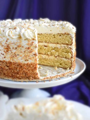 Honey Cake: nice, fluffy texture, moist with a hint of nutty flavor. The honey gives the cake sweetness; a delicious combination with sour cream frosting. This cake just hits 'the spot'. | olgainthekitchen.com