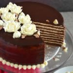 Chocolate Spartak Cake: chocolate-y, 9-layer cake, filled with sour cream frosting, topped with chocolate ganache and decorated with buttercream flowers! | olgainthekitchen.com
