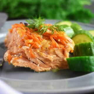 Oven Roasted Salmon: easy, wonderful one-pan salmon meal. Slow roasting salmon yields fall-apart tender salmon paired with sautéed carrots and onion for the extra flavor. | olgainthekitchen.com