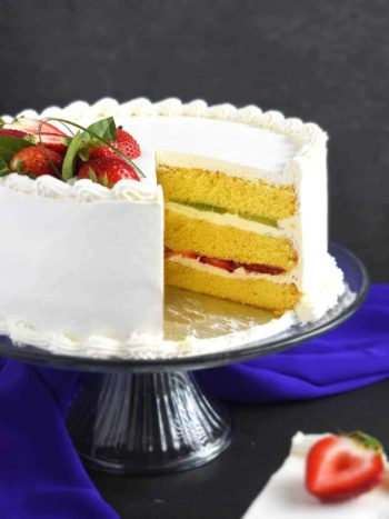 Strawberry Kiwi Cake: an easy all-time family favorite fruity dessert. Moist with layers of fresh strawberries, kiwi and sour cream frosting. | olgainthekitchen.com