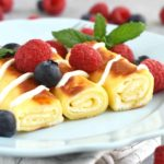 Crepes with Cheese (nalisniki): thin and delicate filled with farmer's cheese filling that melts when you cook in butter or oil. This dish can be made ahead of time, either in full or in part.   olgainthekitchen.com