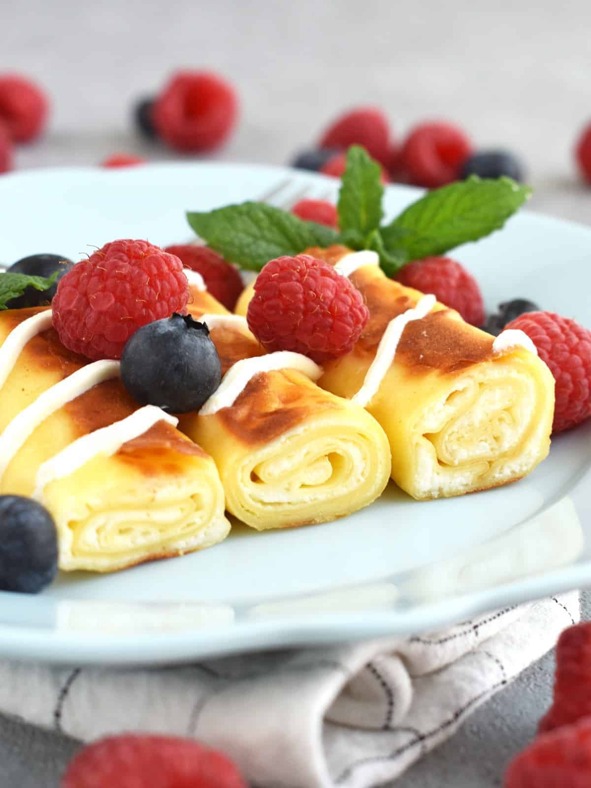 Crepes with Cheese (nalisniki): thin and delicate filled with farmer's cheese filling that melts when you cook in butter or oil. This dish can be made ahead of time, either in full or in part. | olgainthekitchen.com