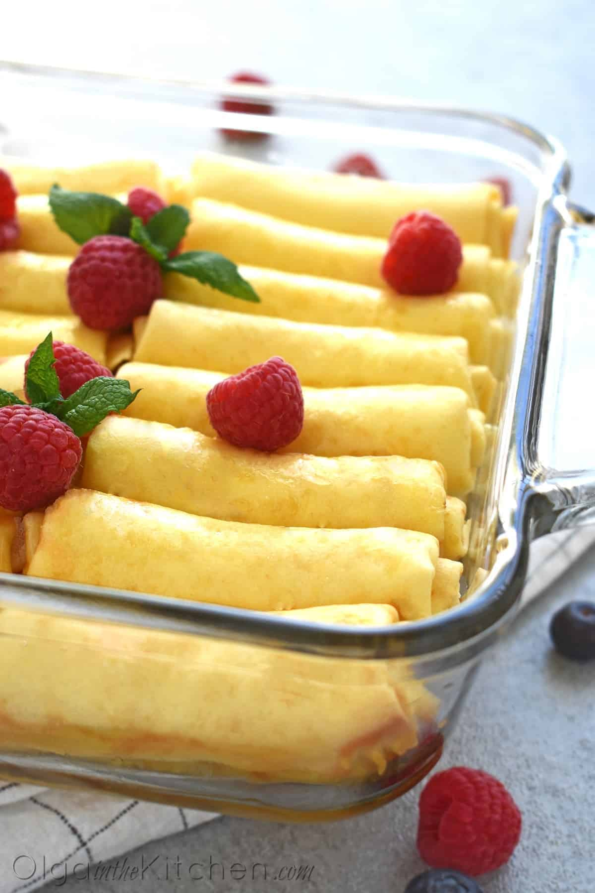 Crepes with Cheese (nalisniki): thin and delicate filled with farmer's cheese filling that melts when you cook in butter or oil. This dish can be made ahead of time, either in full or in part. It's one of the major dishes at weddings, holidays and major events. #cheesecrepes #crepes #farmerscheese #olgainthekitchen #cheeserecipes