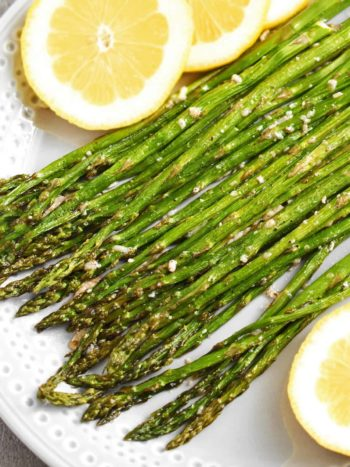 Roasted Asparagus with Parmesan: an easy and super tasty side dish to any main dish in 20 minutes. We like these with grilled pork, beef, chicken or any salmon dish. | olgainthekitchen.com