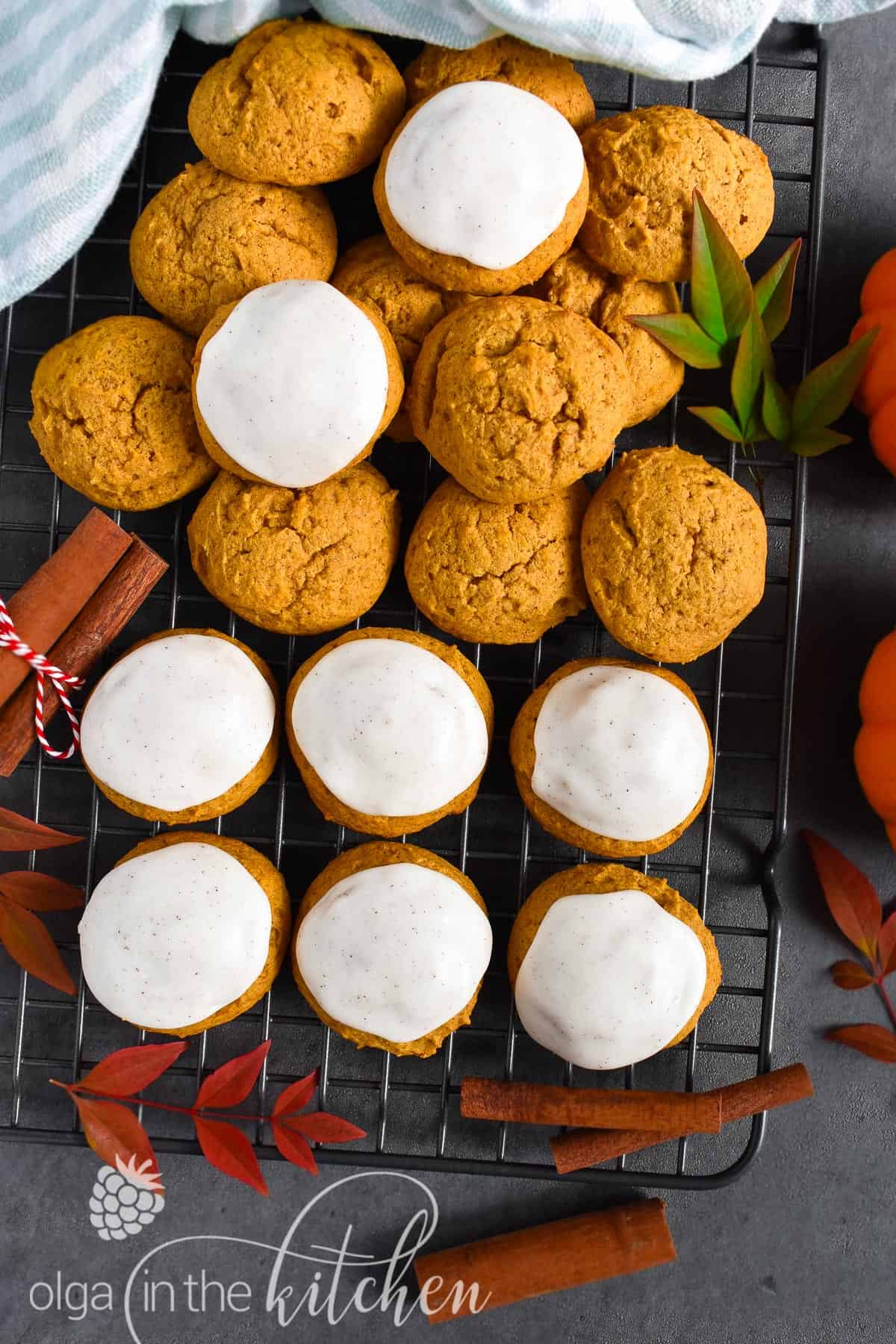 Super soft and fluffy Iced Pumpkin Cookies, topped with a sweet vanilla cinnamon icing and are a must for the fall season. | olgainthekitchen.com