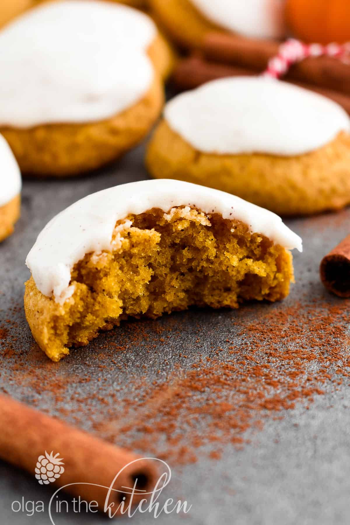 Super soft and fluffy Iced Pumpkin Cookies, topped with a sweet vanilla cinnamon icing and are a must for the fall season.   olgainthekitchen.com