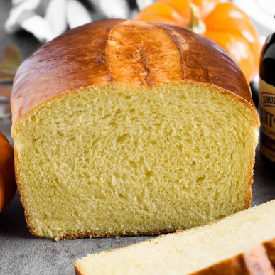 Ukrainian Pumpkin Bread is delicious any time of the year! It has a mild pumpkin flavor from homemade pumpkin puree, a yellow-ish fluffy and tender texture and a shiny dark-brown crust. | olgainthekitchen.com