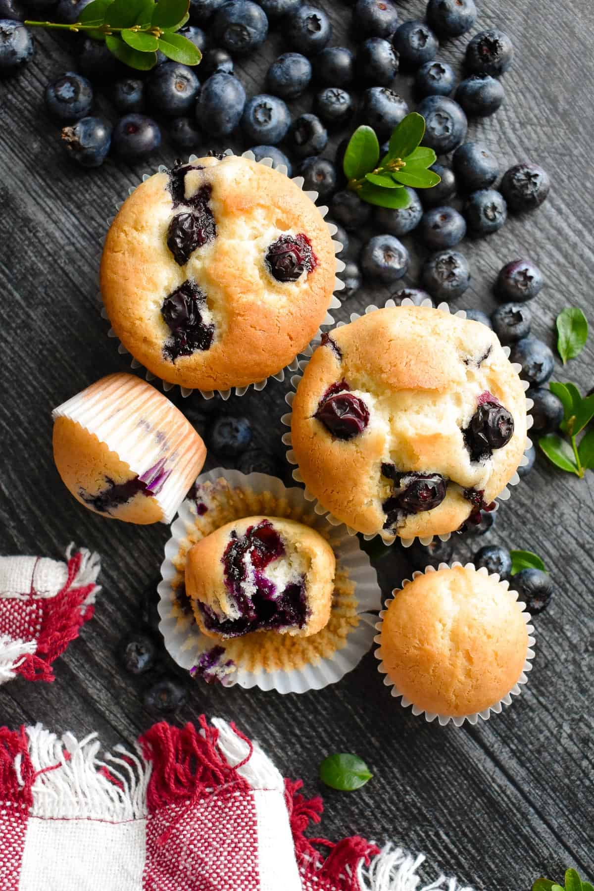 These Sour Cream Blueberry Muffins are bursting with sweet and fresh blueberry flavor. They are soft and perfectly moist on the inside with perfectly golden brown top. #blueberrymuffins #muffins #olgainthekitchen #breakfast #dessert #summer #bread #easyrecipe