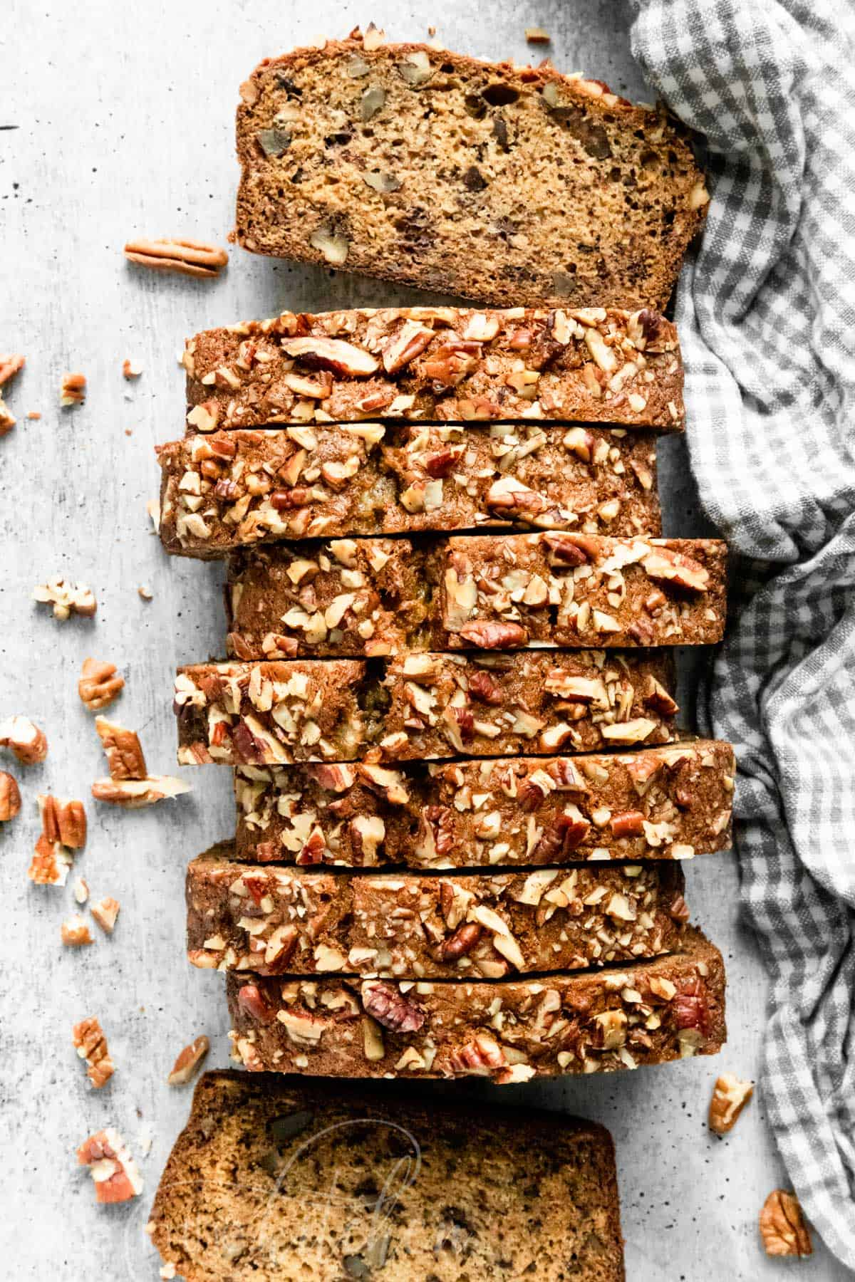 This super-moist Banana Nut Bread Recipe is loaded with bananas, pecans and incredibly soft crumb. It is simple to make and a great way to use those overripe bananas. This moist banana nut bread is so easy and makes a great breakfast on-the-go. #banananutbread #moistbananabread #bananabread #banananutbreadrecipe #bananabreadrecipe #nutbread #olgainthekitchen