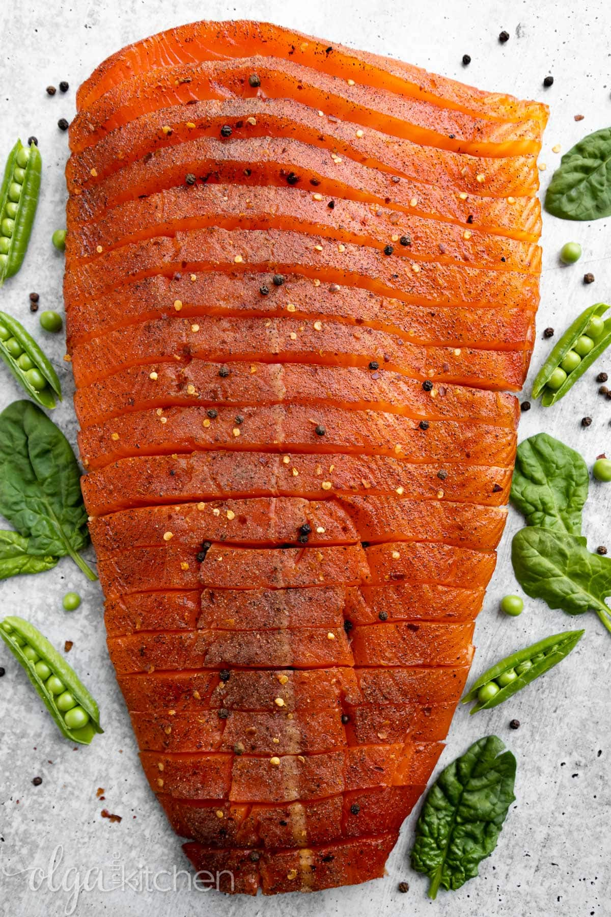 Easy Smoked Salmon is juicy and flaky with a simple salt, sugar and pepper cure. An easy step-by-step guide to make the best and most delicious hot Smoked Salmon at home. #smokedsalmon #salmon #olgainthekitchen #holiday #summer #homemade
