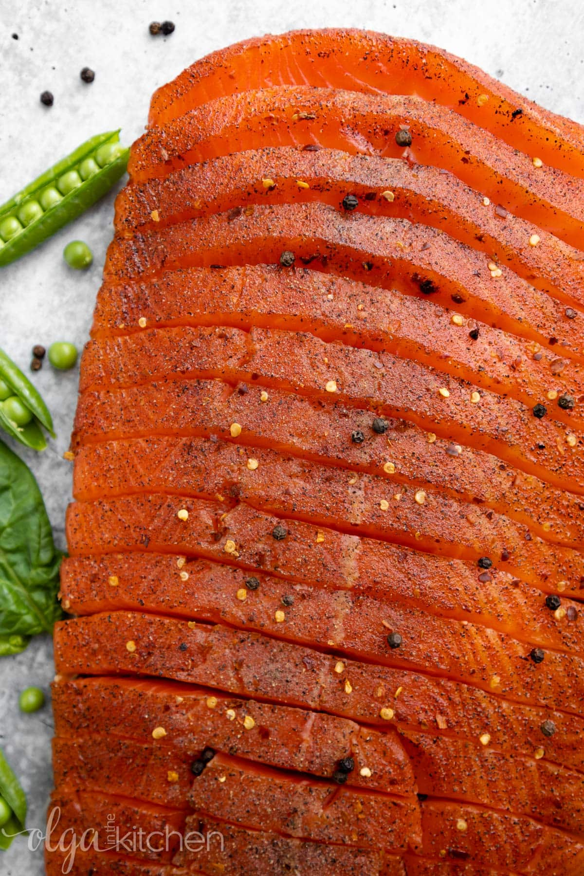 This recipe for Smoked Salmon is juicy and flaky with a simple salt, sugar and pepper cure. An easy step-by-step guide to make the best and most delicious hot Smoked Salmon at home. #smokedsalmon #salmon #olgainthekitchen #holiday #summer #homemade