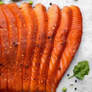 This recipe for Smoked Salmon is juicy and flaky with a simple salt, sugar and pepper cure. An easy step-by-step guide to make the best and most delicious hot Smoked Salmon at home. #smokedsalmon #salmon #olgainthekitchen #holiday #summer #homemade #appetizer