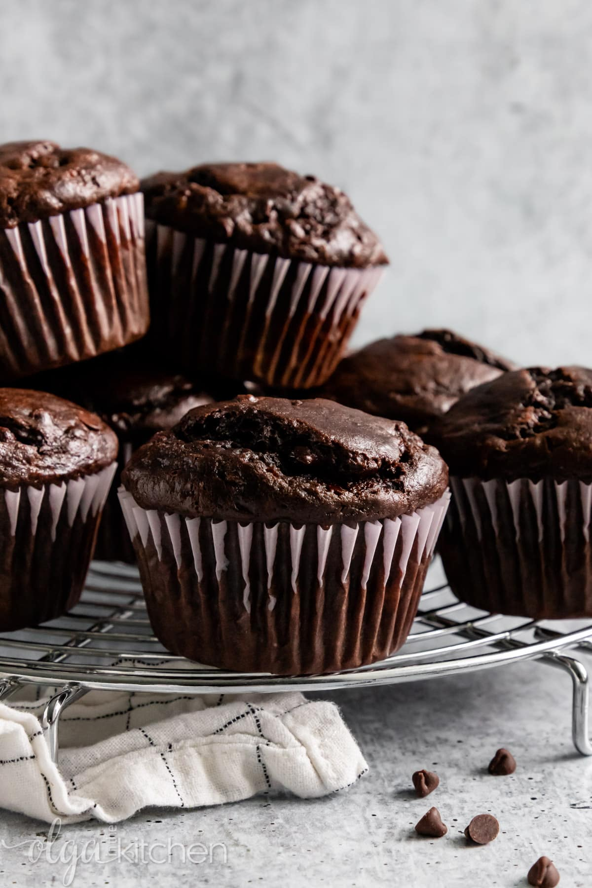 These Double Chocolate Banana Muffins are so easy to make, bursting with rich chocolate flavor and loaded with chocolate chips. They are soft and perfectly moist. #olgainthekitchen #bananamuffins #chocolatemuffins #muffins #chocolatebananamuffins #breakfast