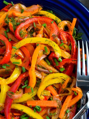 Oven Roasted Pepper Salad is incredibly tasty and so Easy!! One of our favorite make ahead bell pepper recipes! Everyone who tries this marinated roasted sweet pepper recipe, loves it and it always gets rave reviews everywhere it goes. | olgainthekitchen.com